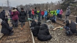 People gather on the train tracks near Kipling GO Station on Feb. 25, 2020 in solidarity with the Wet'suwet'en blockades. (Tracy Tong/CTV News Toronto)