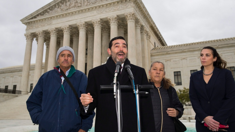 In this file photo, attorney Cristobal Galindo, second from left, speaks accompanied by Jesus Hernandez, left, and Maria Guereca, and attorney Marion Reilly after oral arguments in front of the Supreme Court, Tuesday, Nov. 12, 2019 in Washington. The case involves U.S. border patrol agent Jesus Mesa, Jr., who fired at least two shots across the Mexican border, killing Sergio Adrian Hernandez Guereca, 15, who'd been playing in the concrete culvert between El Paso and Cuidad Juarez. (AP Photo/Alex Brandon)