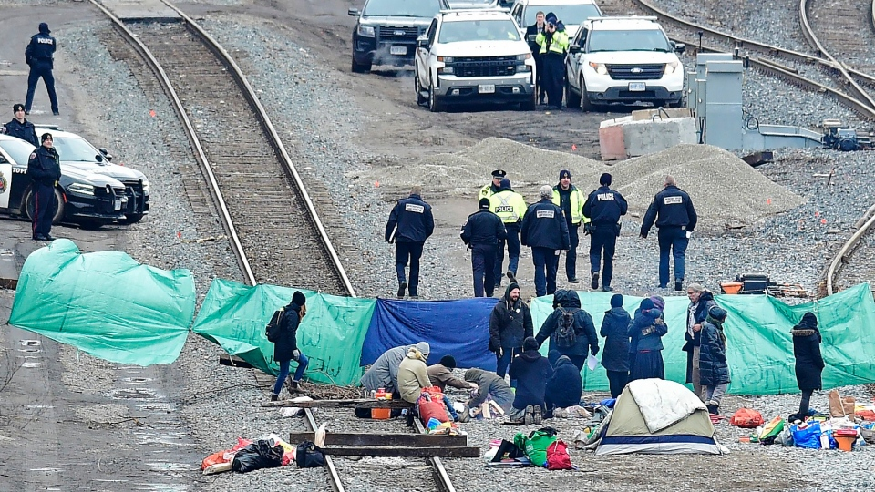 Police leave after speaking with protesters camped on GO Transit railroad tracks in Hamilton, Ont., on Tuesday, Feb. 25, 2020, as they protest in solidarity with Wet'suwet'en Nation hereditary chiefs attempting to halt construction of a natural gas pipeline on their traditional territories. THE CANADIAN PRESS/Frank Gunn