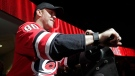 Dave Ayres sounds the siren before an NHL hockey game between the Carolina Hurricanes and the Dallas Stars in Raleigh, N.C., on Tuesday, Feb. 25, 2020. Ayres became a sudden hero to Hurricanes fans when he came into the game as an emergency goaltender in Toronto on Saturday and won the game. (AP / Chris Seward)