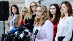 """Actress Louisette Geiss addresses the media at a news conference by the """"Silence Breakers,"""" a group of women who have spoken out about Hollywood producer Harvey Weinstein's sexual misconduct, at Los Angeles City Hall, Tuesday, Feb. 25, 2020, in Los Angeles. A jury in Manhattan convicted Weinstein on Monday of raping one woman in 2013 and sexually assaulting another in 2006. (AP / Chris Pizzello)"""