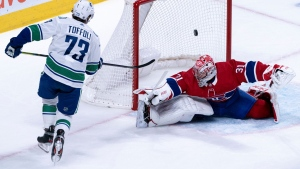 Vancouver Canucks' Tyler Toffoli scores past Montreal Canadiens goaltender Carey Price during overtime in NHL hockey action in Montreal, Tuesday, Feb. 25, 2020. THE CANADIAN PRESS/Paul Chiasson