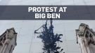 Climate protesters spray Big Ben with black liquid