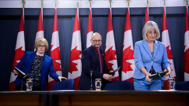"Carla Qualtrough, Minister of Employment, Workforce Development and Disability Inclusion, left to right, David Lametti, Minister of Justice and Attorney General of Canada, and Patty Hajdu, Minister of Health, make an announcement regarding a Bill entitled ""An Act to amend the Criminal Code (medical assistance in dying)"" during a press conference at the National Press Theatre in Ottawa on Monday Feb. 24, 2020. THE CANADIAN PRESS/Sean Kilpatrick"