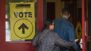 Voters enter the polling station at St. Rita Catholic School during election day in Toronto on Monday, October 21, 2019. THE CANADIAN PRESS/ Tijana Martin