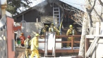 Crews battle a fire in the 1400 block of Athol Street on Feb. 26, 2020