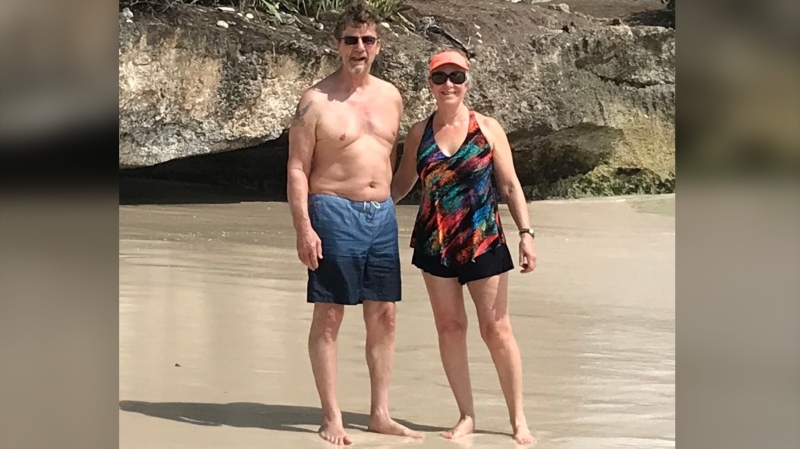 Kenneth Elliott and his wife Linda Brooks, on a beach in Barbados just days before Ken was shot and paralyzed in a home invasion on the island. (Linda Brooks)