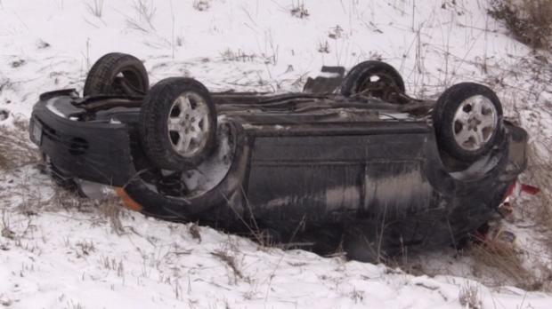 Slick roads contribute to car flipped in ditch