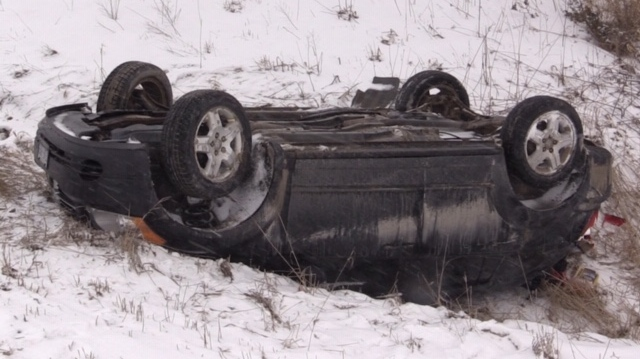 A car flipped in a ditch is seen near Molesworth, Ont. on Wednesday, Feb. 26, 2020. (Scott Miller / CTV London)