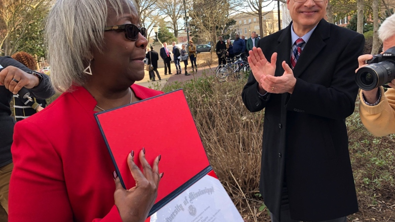 In this file photo, Linnie Liggins Willis shows off her 1970 University of Mississippi diploma that she received from the university's provost, Noel Wilkin, on Tuesday, Feb. 25, 2020, on the Ole Miss campus in Oxford, Miss. She was among the eight University of Mississippi students who were suspended from the university for protesting racial inequality in February 1970. Although she had completed her academic requirements to earn the diploma, the university did not award it at the time. (AP Photo / Brittany M. Brown)