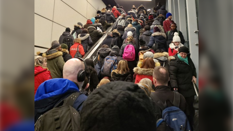 Passengers leave the St. Laurent LRT station to board R1 buses after an overhead power component became loose Feb. 26, 2020. (Photo courtesy of Christina Pulickal / Twitter)