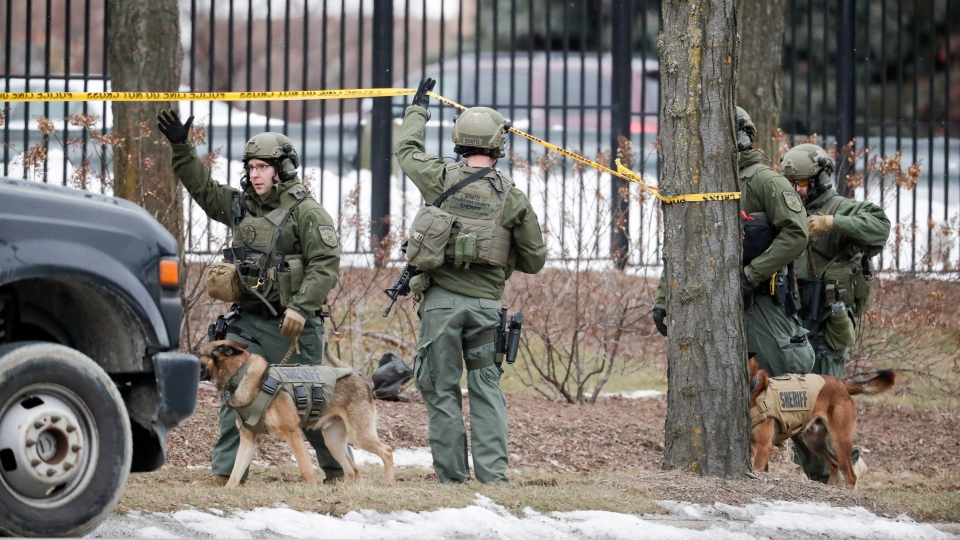 Police respond to reports of an active shooting at the Molson Coors Brewing Co. campus in Milwaukee, Wednesday, Feb. 26, 2020. (AP Photo/Morry Gash)