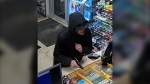 Surveillance photo of a man suspected in two robberies. (EPS)