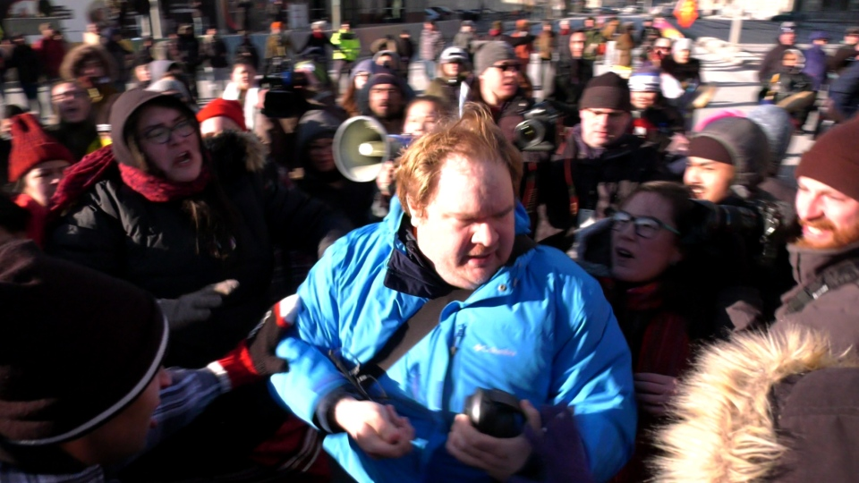 Tensions boil over during a protest at Portage and Main on Feb. 26, 2020. (Source: CTV News WInnipeg)