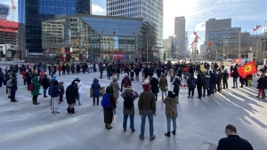 People shut down the corner of Portage Ave. and Main St. in Winnipeg in solidarity with the Wet'suwet'en hereditary chiefs opposed to the LNG pipeline in northern British Columbia on Wednesday, February 26, 2020. THE CANADIAN PRESS/Steve Lambert