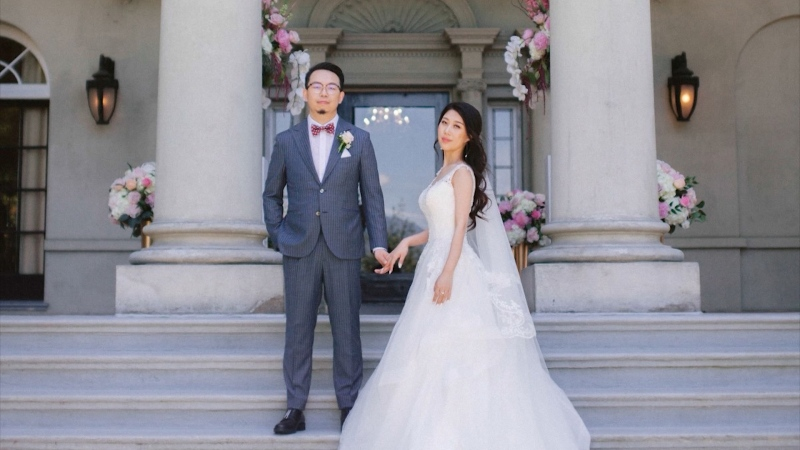 Elizabeth Su and her husband Simon Zheng are pictured on their wedding day in June 2019. Su, a Metro Vancouver resident, remains in lockdown in Wuhan. (Provided by Simon Zheng)