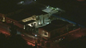 Los Angeles police are looking for the suspects who took off with a hearse that had a body inside. (KTLA)