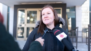 Emily Eaton, a professor in the department of geography and environmental science at the University of Regina, speaks to reporters at the Court of Queen's Bench in Regina on Wednesday Feb. 26, 2020.THE CANADIAN PRESS/Michael Bell