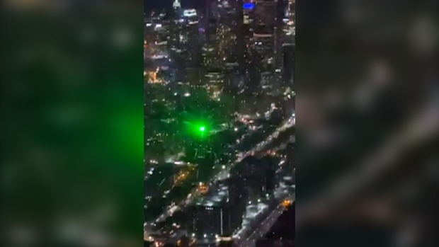 Video shows green laser strike air ambulance in downtown Toronto