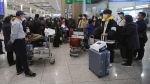 South Koreans tourists gather after returning from Israel at Incheon International Airport in Incheon, South Korea, Tuesday, Feb. 25, 2020. (THE CANADIAN PRESS/AP, Ahn Young-joon)