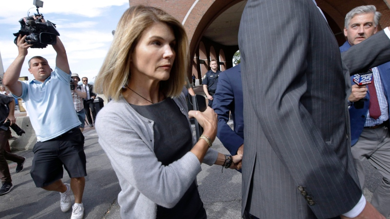 In this Aug. 27, 2019, file photo, actress Lori Loughlin departs federal court in Boston, after a hearing in a nationwide college admissions bribery scandal. Loughlin and her fashion designer husband Mossimo Giannulli are fighting expanded charges against them in the college admissions bribery scandal. (AP Photo/Steven Senne, File)
