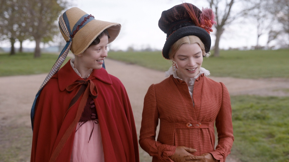 This undated image provided by Focus Features shows actors Mia Goth, left, as Harriet Smith and Anya Taylor-Joy as Emma Woodhouse in director Autumn de Wilde's film