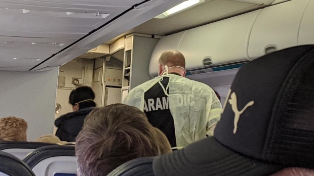 Paramedics board WestJet flight 448 in Winnipeg to respond to a medical issue on Feb 27, 2020. (Source: Theresa Marion)