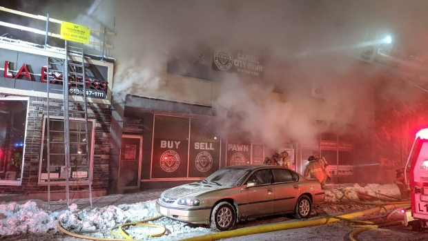 Firefighters battle blaze at Montreal Road pawn shop