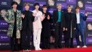 In this Jan. 5, 2020, file photo, members of South Korean K-Pop group BTS pose for photos during the Golden Disk Awards in Seoul, South Korea. (AP Photo/Ahn Young-joon, File)