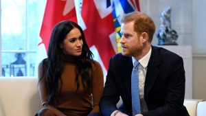 Britain's Prince Harry and Meghan, Duchess of Sussex gesture during their visit to Canada House in thanks for the warm Canadian hospitality and support they received during their recent stay in Canada, in London, Tuesday, Jan. 7, 2020. The NDP's Canadian Heritage critic says he believes Prince Harry and his family should pay for their own security costs while they're in Canada. THE CANADIAN PRESS/AP, Daniel Leal-Olivas/Pool Photo