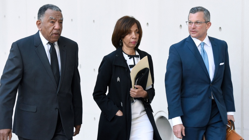 Former Baltimore mayor Catherine Pugh, center, and her attorney Steven Silverman, right, arrive for a sentencing hearing at U.S. District Court in Baltimore on Thursday, Feb. 27, 2020. (AP Photo/Steve Ruark)