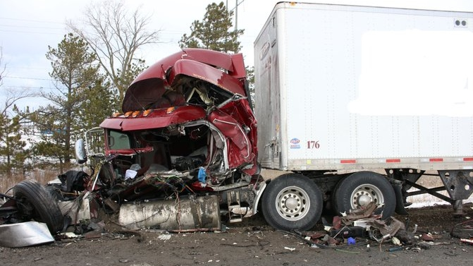 A transport is destroyed following a crash on Highway 401 on Thursday, Feb. 27, 2020. (Courtesy OPP)