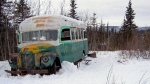 This March 21, 2006, file photo, shows the abandoned bus where Christopher McCandless starved to death in 1992 on Stampede Road near Healy, Alaska. Scores of travelers following his journey along the Stampede Trail have been rescued and others have died in the harsh back-country terrain. Now families of some of those who died are proposing looking at building a footbridge over the Teklanika River. (AP Photo/Jillian Rogers, File )
