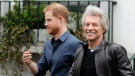 Britain's Prince Harry, the Duke of Sussex, left, smiles while walking along with musician Jon Bon Jovi as he leaves Abbey Road Studios in London, Friday, Feb. 28, 2020. The Prince met musician Jon Bon Jovi and members of the Invictus Games Choir, who are recording a special single in aid of the Invictus Games Foundation. (AP Photo/Kirsty Wigglesworth)