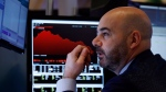 Trader Fred DeMarco works on the floor of the New York Stock Exchange, Friday, Feb. 28, 2020. Global stock markets are falling further on spreading virus fears. (AP Photo/Richard Drew)