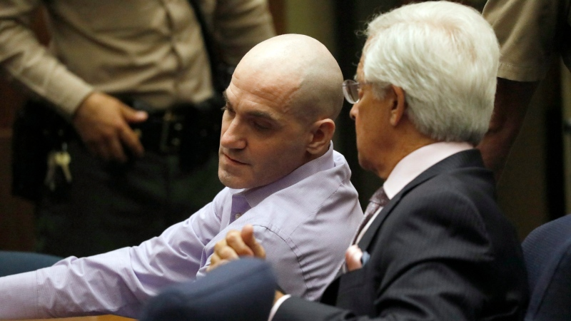 In this file photo Michael Gargiulo, left, and his attorney Daniel Nardoni confer as Gargiulo's guilty verdicts on all counts are read in Los Angeles Superior Court Thursday, Aug. 15, 2019. A jury found Gargiulo guilty of fatally stabbing two women and attempting to kill a third in their Southern California homes. (Al Seib/Los Angeles Times via AP, Pool)