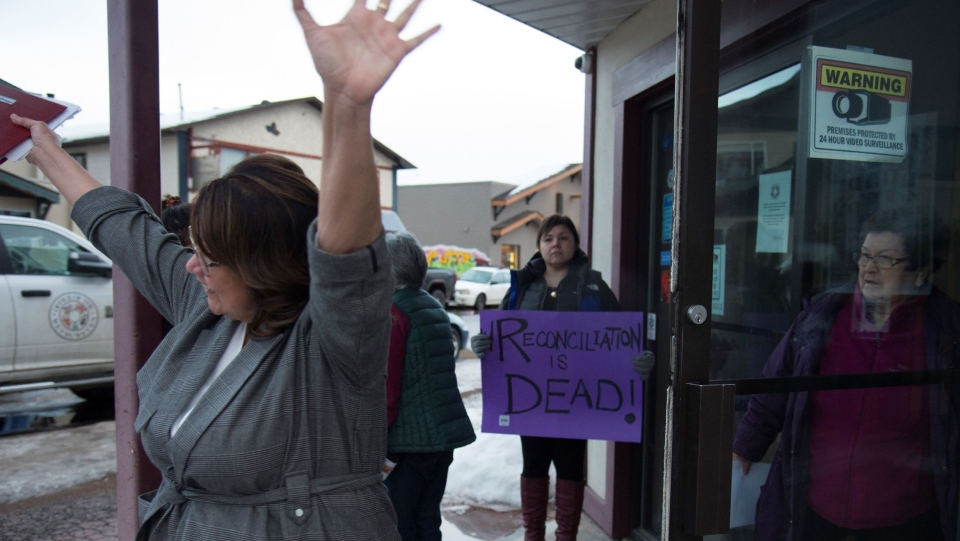 Wet'suwet'en member Bonnie George raises her arms as she leave talks with Minister of Crown-Indigenous Relation, Carolyn Bennett and the Wet'suwet'en hereditary chiefs in Smithers, B.C., Thursday, February 27, 2020. All sides where meeting to discuss the ending blockades happening across the country. The blockades are set up by those opposed to the LNG pipeline in northern British Columbia. THE CANADIAN PRESS/Jonathan Hayward