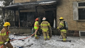 Firefighters work at the scene of a house fire northwest of Denfield, Ont. on Friday, Feb. 28, 2020. (Sean Irvine / CTV London)