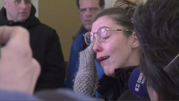 Francois Senecal's daughter cries as she speaks to the media outside a Saint-Jerome courtroom after her father was charged with first-degree murder in the death of Oceane Boyer, a 13-year-old family friend.