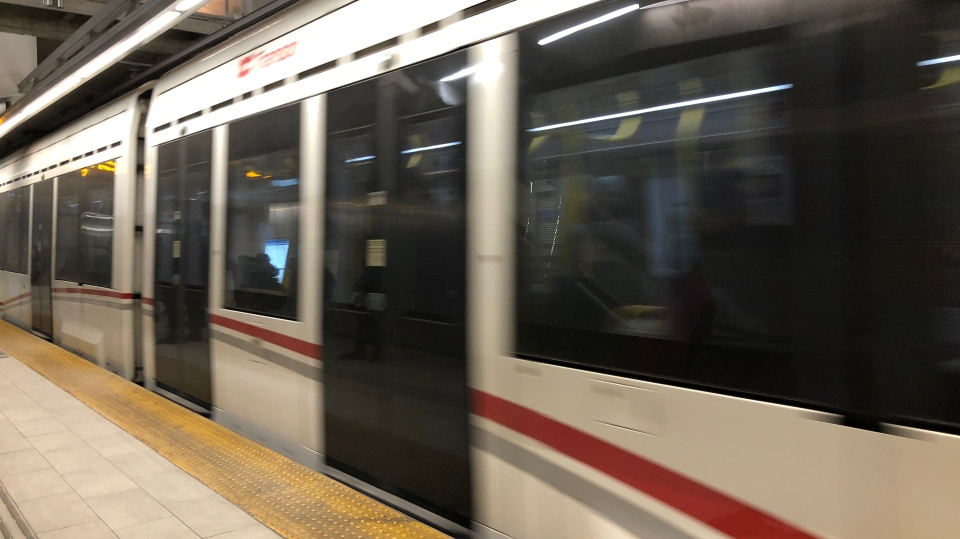 An LRT train rushes by the platform at Rideau Station. (Ted Raymond / CTV News Ottawa)