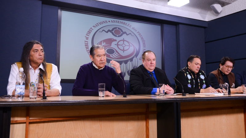 In this file photo, Mohawk Council of Kahnawake Grand Chief Joseph Norton, second from left, is joined by First Nations leaders as they discusses the current situation and actions relating to the Wet'suwet'en people during a press conference at the National Press Theatre in Ottawa on Tuesday, Feb. 18, 2020. THE CANADIAN PRESS/Sean Kilpatrick