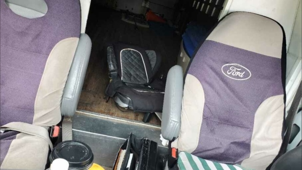 Truck stopped in Burnaby for having adult passenger riding on child's booster seat