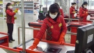"In this Friday, Feb. 28, 2020, photo, clerks disinfect checkout counters at a department store amid growing concern over the coronavirus outbreak in Pyongyang, North Korea. North Korean leader Kim Jong Un has called for stronger anti-virus efforts to guard against COVID-19, saying there will be ""serious consequences"" if the illness spreads to the country. (Kyodo News via AP)"