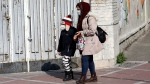 People walk as they wear masks in downtown Tehran, Iran, Thursday, Feb. 27, 2020. (AP Photo/Vahid Salemi)
