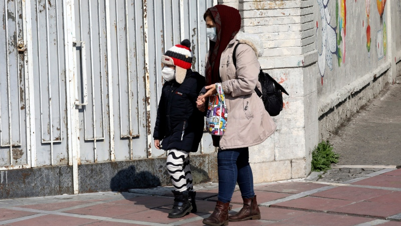 People walk as they wear masks in downtown Tehran, Iran, Thursday, Feb. 27, 2020. (AP Photo/Vahid Salemi)