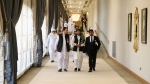 Afghanistan's Taliban delegation arrive for the agreement signing between Taliban and U.S. officials in Doha, Qatar, Saturday, Feb. 29, 2020. (AP Photo/Hussein Sayed)