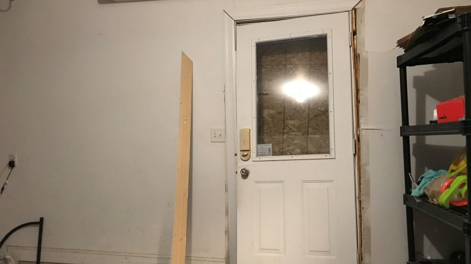 A view from the interior of the house that was struck. The door has been boarded up.
