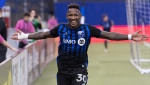 Montreal Impact's Romell Quioto celebrates after scoring against the New England Revolution during first half MLS soccer action in Montreal, Saturday, February 29, 2020. THE CANADIAN PRESS/Graham Hughes
