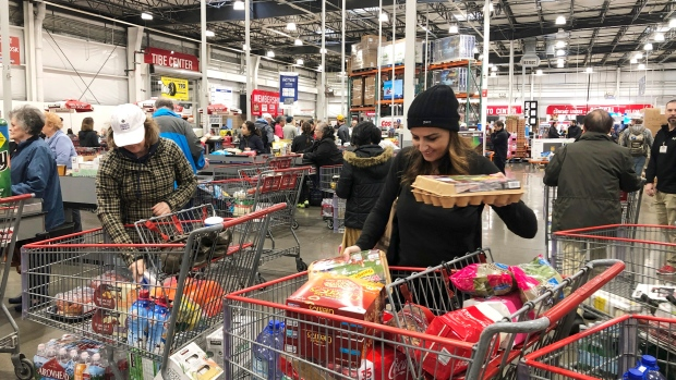 People are sharing images of long lines, empty shelves at Costco amid COVID-19