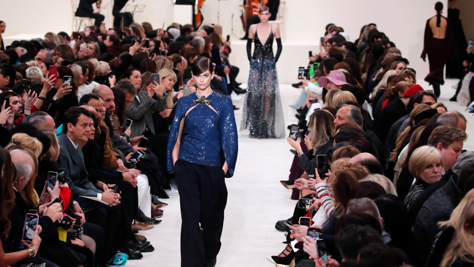 Model Kaia Gerber wears a creation for the Valentino fashion collection during Women's fashion week Fall/Winter 2020/21 presented in Paris, Sunday, March 1, 2020. (AP Photo/Francois Mori)